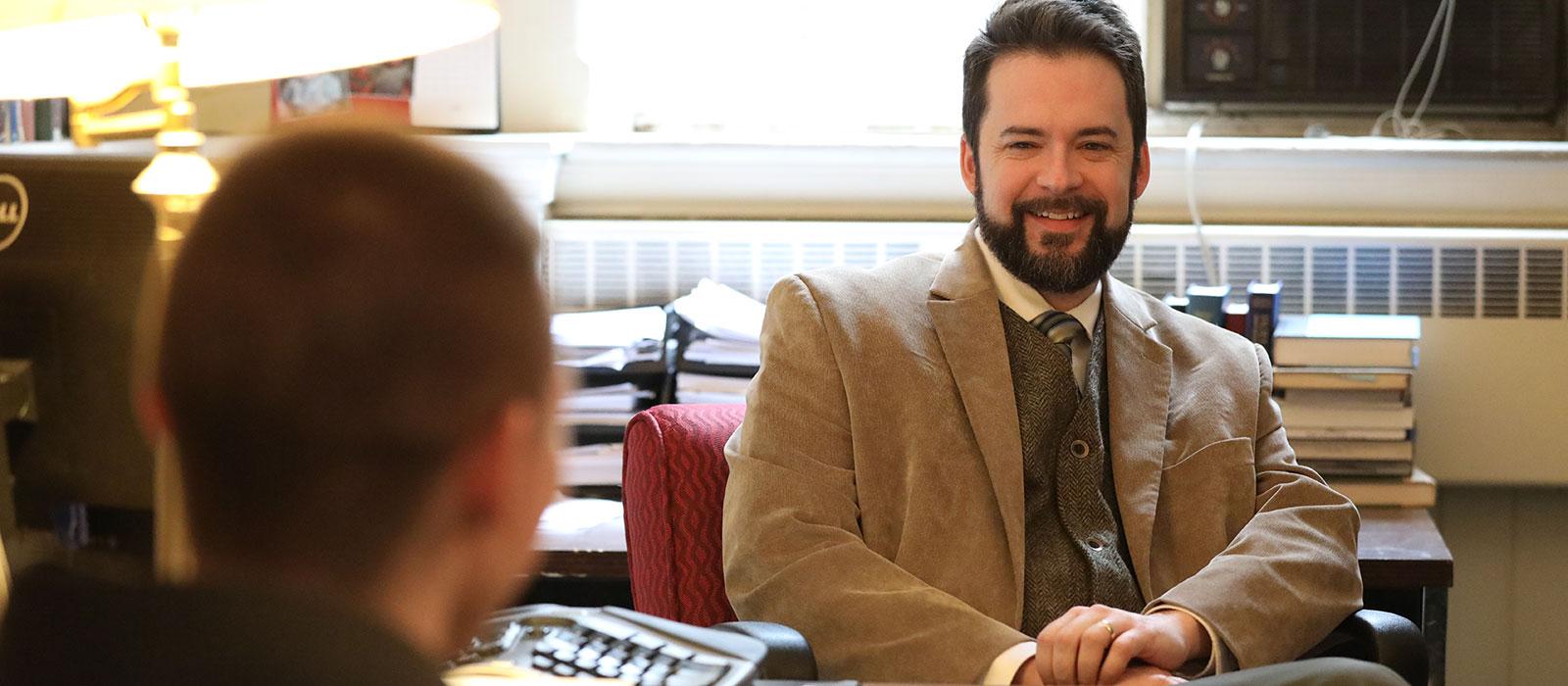 Professor Joshua Benson with a student